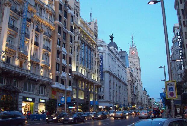 Gran Via, a downtown avenue in Madrid (Spain), at dusk.