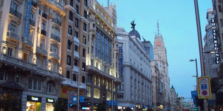Gran Via, a downtown avenue in Madrid (Spain), at dusk.